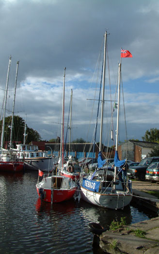 Boats mooored at Heybridge Basin in Essex East Anglia